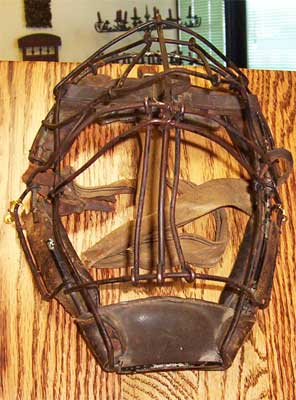 Metal and leather restored on antique catcher mask